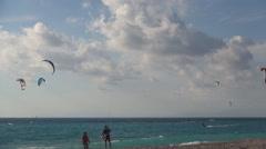 Tourists training in kite-boarding water sport on Mediterranean seashore. - stock footage