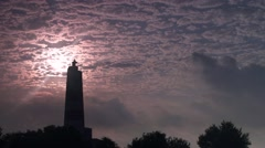 Lighthouse surrounded by fast clouds Stock Footage