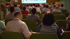 People listening to speaker during business educational training conference Stock Footage