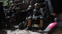 Knights take a rest between battles in full armor. Stock Footage