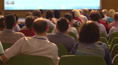 People listening to speaker during business educational training conference - stock footage
