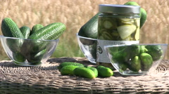 Fresh cucumber and glass jars with pickled cucumbers Stock Footage