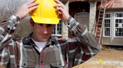 Construction: home builder puts on safety glasses and crosses arms Stock Footage