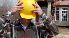 Construction: home builder puts on safety glasses Stock Footage