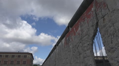 Berlin wall dramatic symbol hole concrete historic barrier protection west east  Stock Footage