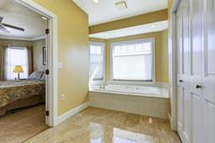 bathroom with shiny tile floor in master bedroom - stock photo