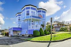 Big bright blue house with american flag Stock Photos
