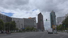 Potsdamer Platz traffic street car pass modern building skyscraper tower Berlin Stock Footage
