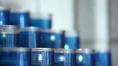 Dozens of blue candles within a church building Stock Footage