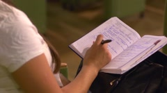A girl takes notes during educational lecture or business conference Stock Footage