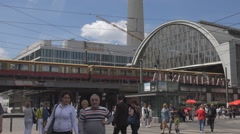 Alexanderplatz train station public square tourist visit Berlin police car pass  Stock Footage