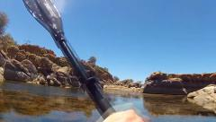 Man Paddles Kayak Over Thick Aquatic Vegetation- Lake Watson - stock footage