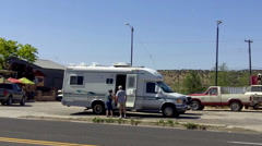 Mature Senior Couple Getting Into Compact Recreational Vehicle RV Stock Footage