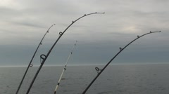 Four fishing trolling rods 2 Stock Footage
