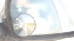 Shot through the rear-view mirror on the fast-moving car Stock Footage