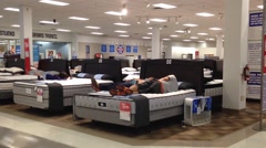 Customer shopping mattress Stock Footage