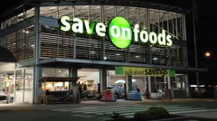 Save on foods at night scene Stock Footage