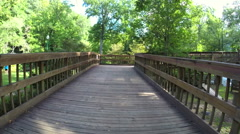 Walking on a foot bridge Stock Footage