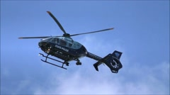 State Police Helicopter flying overhead Stock Footage