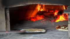 Cooking pizza into a wood over. Stock Footage