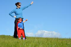 superhero mother and child - girl power - stock photo