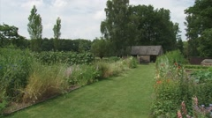 Pan traditional kitchen garden in summer Stock Footage
