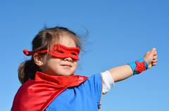 Superhero child - girl power Stock Photos