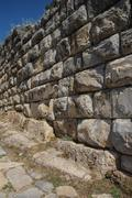 Massive ashlar masonry wall Stock Photos