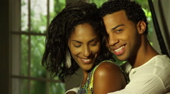 Stock Video Footage of Black Hispanic Male and Female embrace, caress, smile to camera