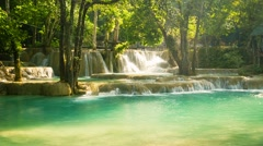 Kouang si waterfall, laos, luang prabang. water flows through the calcareous Stock Footage