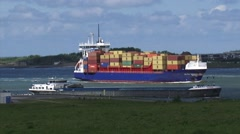MAASMOND, PORT OF ROTTERDAM -  Open top container vessel Elite + barge inbound Stock Footage