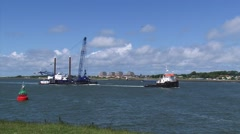 Tugboat Marian V towing Crane barge Dina M inbound on Nieuwe Waterweg Stock Footage