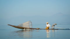 Local fisherman is moving quickly on the boat with a modern engine. inle lake Stock Footage