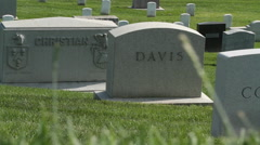 Cinematic tracking shot of graves at Arlington National Cemetery Stock Footage