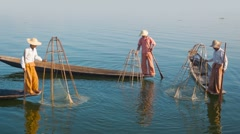 Village fishermen on traditional boats with fish traps. inle lake, burma Stock Footage