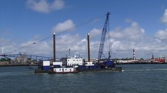 PORT OF ROTTERDAM - Crane barge Dina M in tow on Nieuwe Waterweg. Stock Footage
