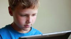 Boy Plays On Ipad Stock Footage