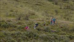 Children walking on the hillside Stock Footage