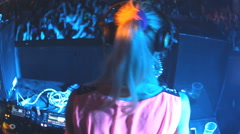 DJ girl mixing music  Dee jay  at disco party clubbing festival Stock Footage