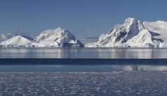 mountains and islands of the antarctic peninsula in winter sunny day - stock photo