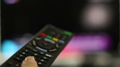 Stock Video Footage of Smart tv and hand pressing remote control, close up HD