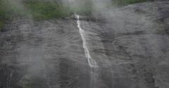 4k, norway, narrow waterfall in fog Stock Footage
