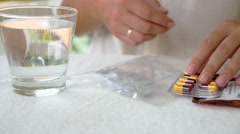 Woman with Packings of Pills and Capsules of Medicine. Stock Footage