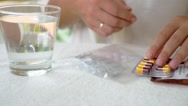 Stock Video Footage of Woman with Packings of Pills and Capsules of Medicine.