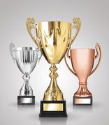 Champion trophies on grey background Stock Photos