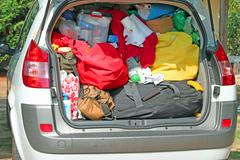 trunk overloaded with bags and bags for family summer holidays - stock photo