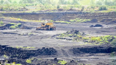 Buldogeers in open pit lignite coal mine panning shoot Stock Footage