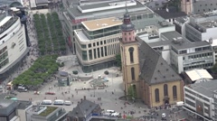 ULTRA HD 4K Aerial view busy Zeil shopping street church building Frankfurt city Stock Footage