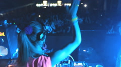 Girl DJ  mixing music  Dee jay  at disco party clubbing festival Stock Footage
