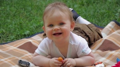 Stock Video Footage of 06 Cute baby boy on blanket in grass laughing at camera